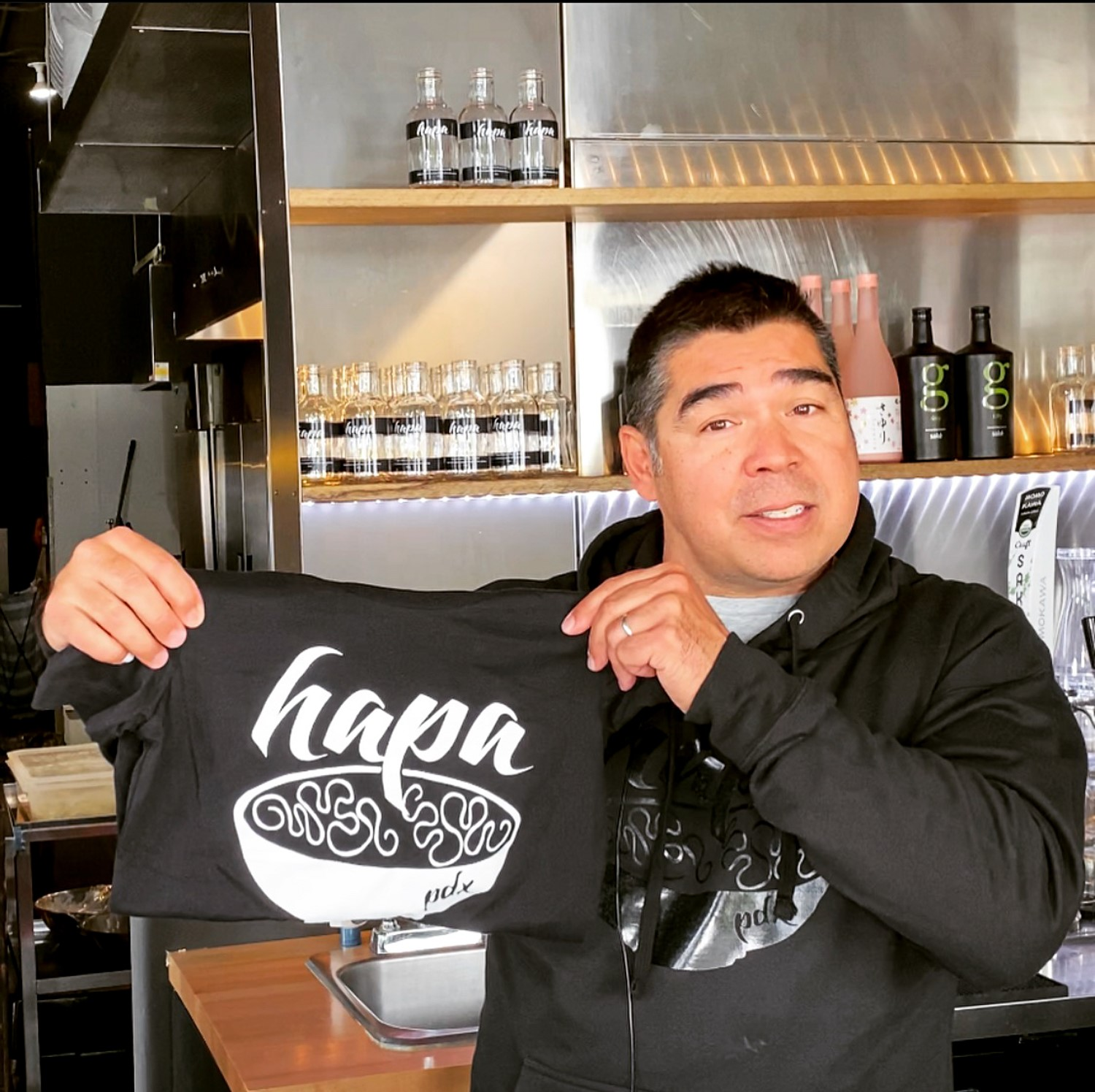 Mike showing off a Hapa Shirt while wearing a Hapa PDX Black-on-Black Hoodie